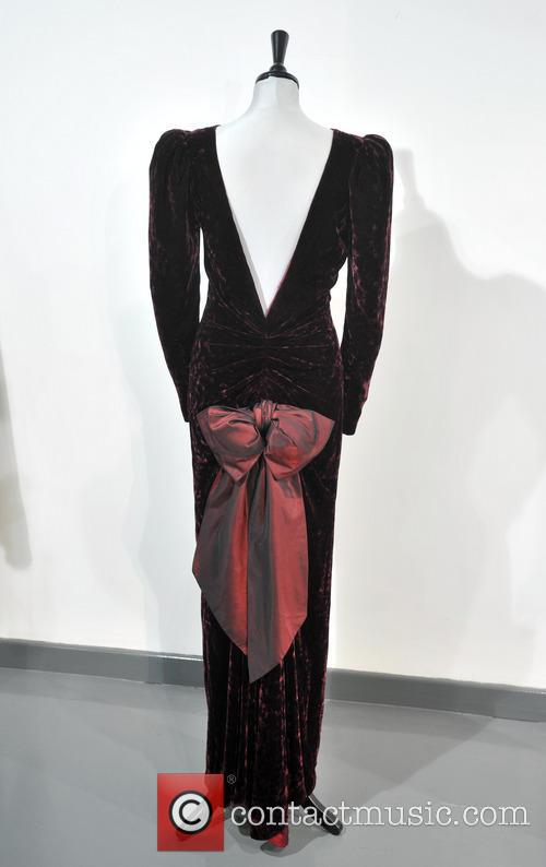 A Catherine Walker Burgundy Crushed Velvet Evening Gown, Worn For A State Visit To Australia, To The Film Premiere Of 'back To The Future' In 1985. Est. Gbp40-50000. and Atmosphere 3