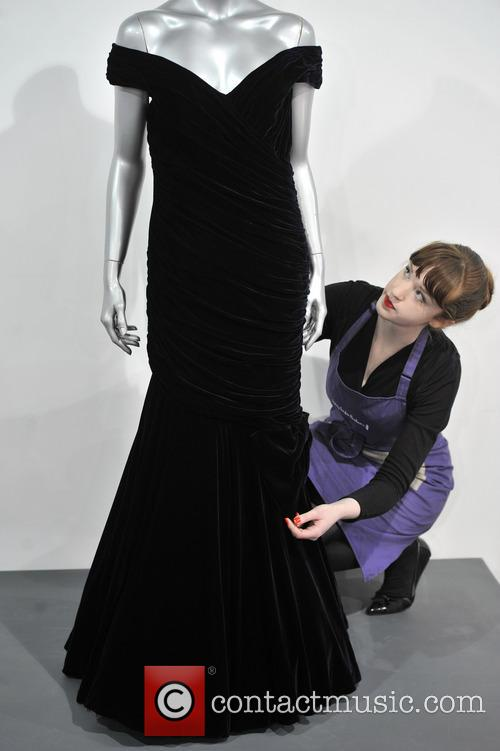 A Victor Edelstein Midnight-blue Velvet Evening Gown Worn For The State Dinner At The White House Given By President Reagan In 1985. Est. Gbp200-300000. and Atmosphere 1
