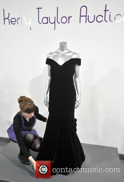 A Victor Edelstein Midnight-blue Velvet Evening Gown Worn For The State Dinner At The White House Given By President Reagan In 1985. Est. Gbp200-300000. and Atmosphere 5