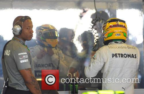 lewis hamilton helmets up watched by his 3558094
