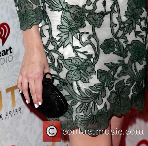 Emmy Rossum and clutch 1