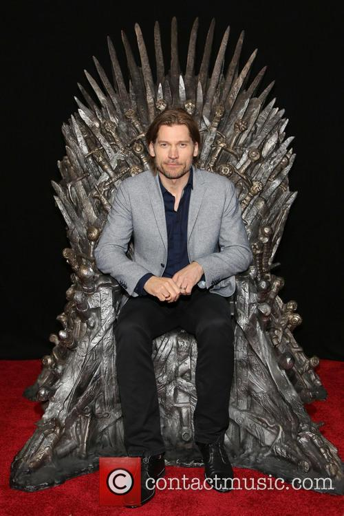 Nikolaj Coster-Waldau sitting upon The Iron Throne