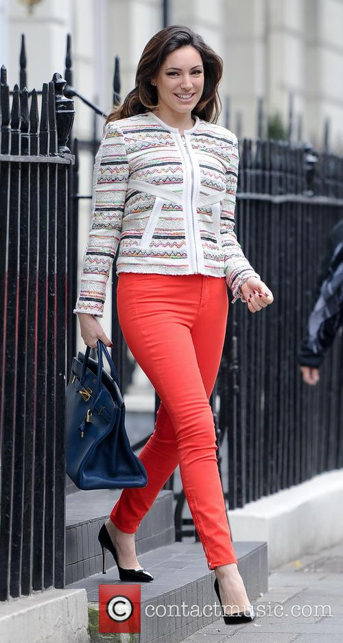 Kelly Brook leaving her home