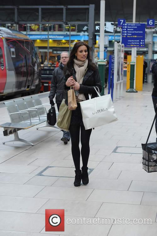 Melanie Sykes and Gary Cockerill at Manchester Piccadilly train station catching the train to London.