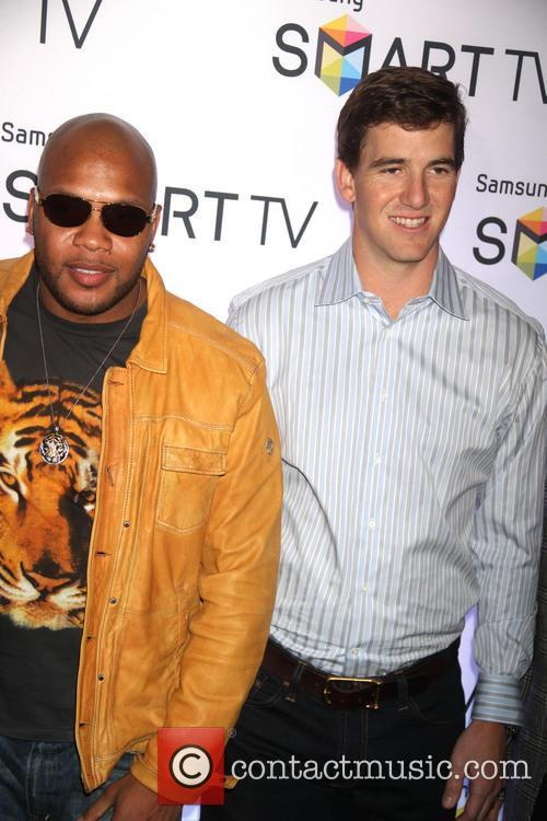 Flo Rida and Eli Manning 11