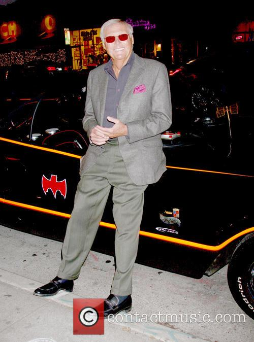 adam west poses with the batmobile the 3570094