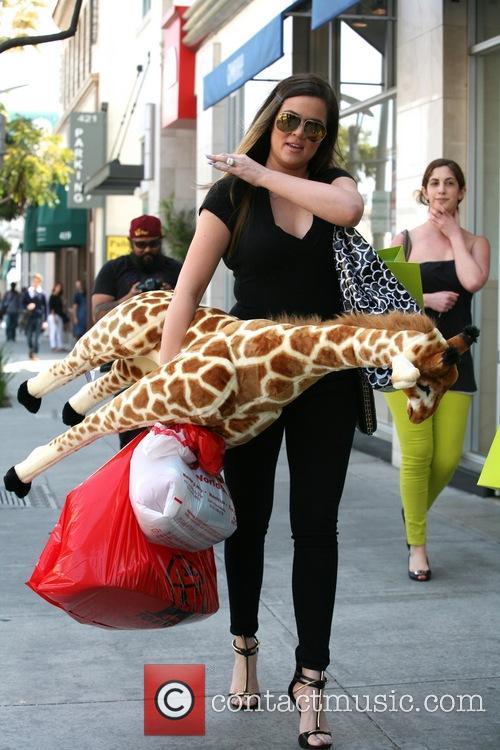 khloe kardashian khloe kardashian holding a plush 3570754