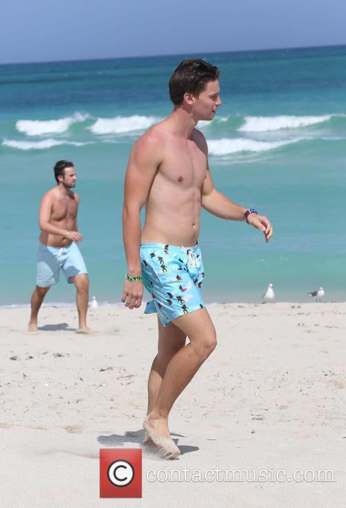 Patrick Schwarzenegger enjoys a day at the beach with friends