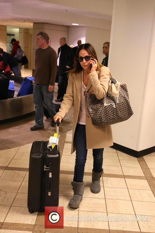 Natalie Imbruglia arrives with luggage and a Goyard...