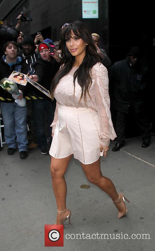 A very pregnant Kim Kardashian i seen arriving...