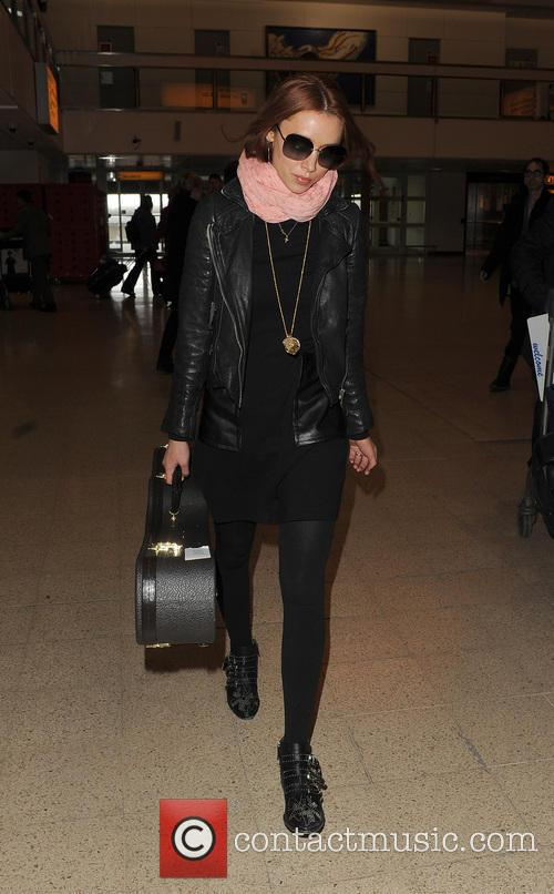 una healy the saturdays at heathrow airport 3581747
