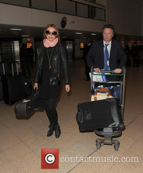 una healy the saturdays at heathrow airport 3581754