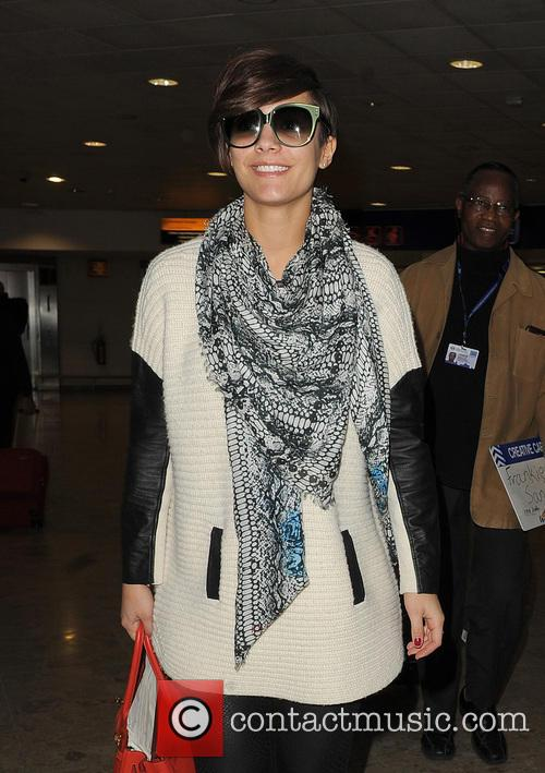 The Saturdays arrive at Heathrow Airport