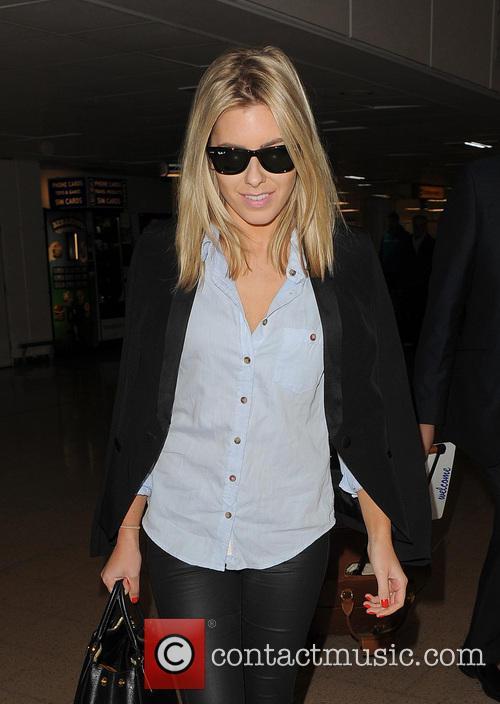 The Saturdays arrive at Heathrow Airport