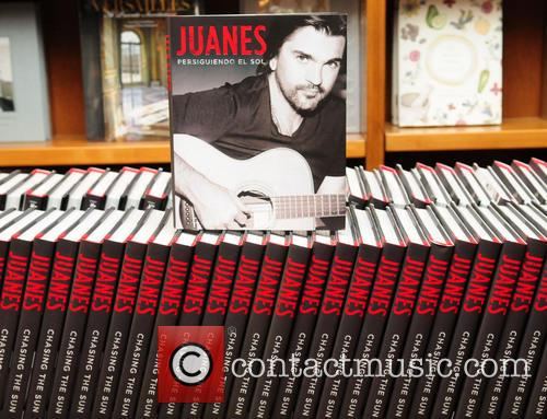 Juanes signs copies of his book 'Chasing The...