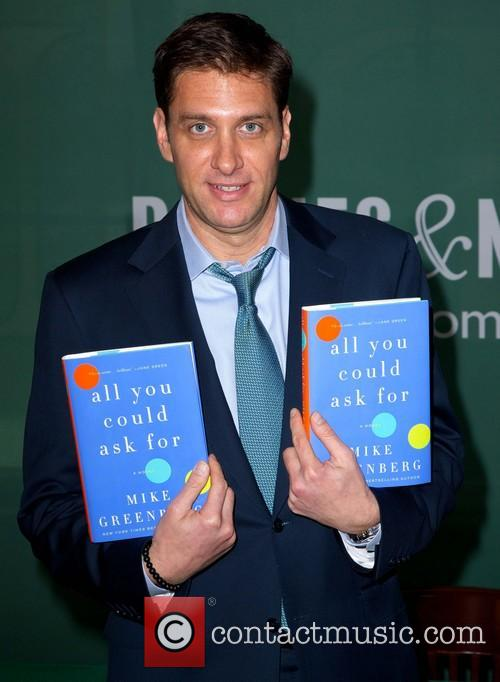 Mike Greenberg signs copies of his new book...