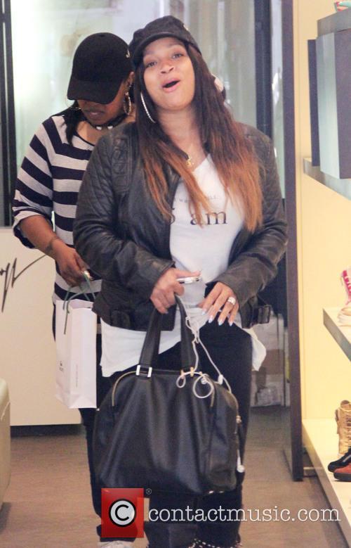 Simone Johnson goes shopping at Giuseppe Zanotti shoe...
