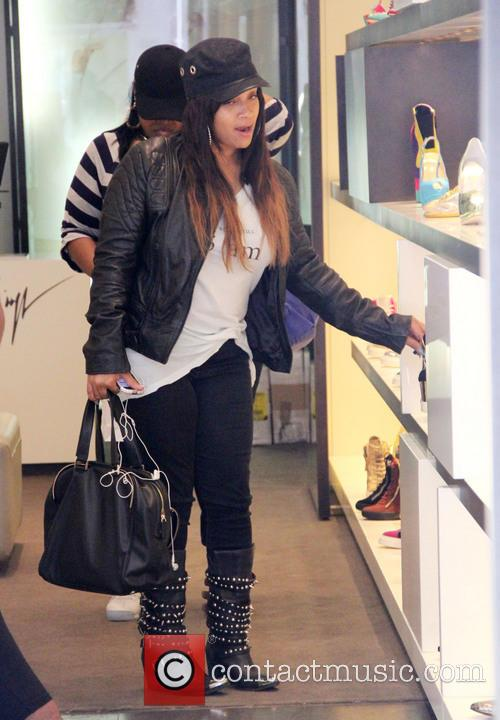 Simone Johnson goes shopping at Giuseppe Zanotti shoe...
