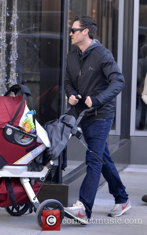 Brian Austin Green walks his baby son Noah...