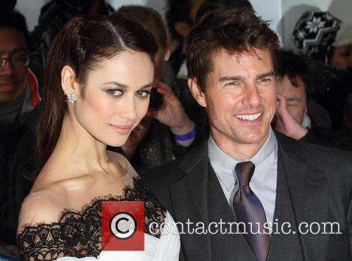 Olga Kurylenko and Tom Cruise 4