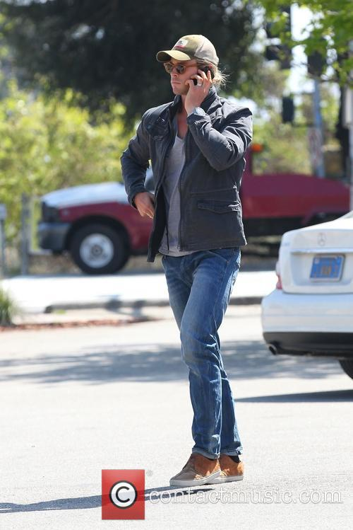Chris Hemsworth seen on his phone