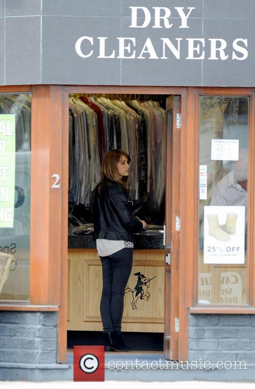 Samia Ghadie collects her dry cleaning