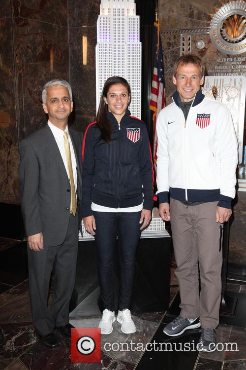 U.S. Soccer players and coaches light The Empire...