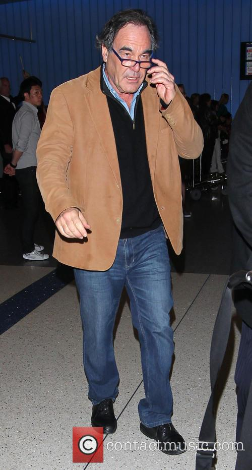Oliver Stone arrives at LAX