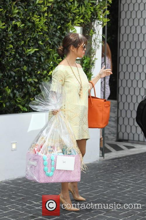 The Kardashian sisters are seen heading to a...