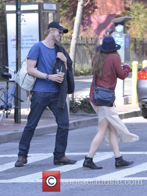 Elizabeth Olsen and Boyd Holbrook walking