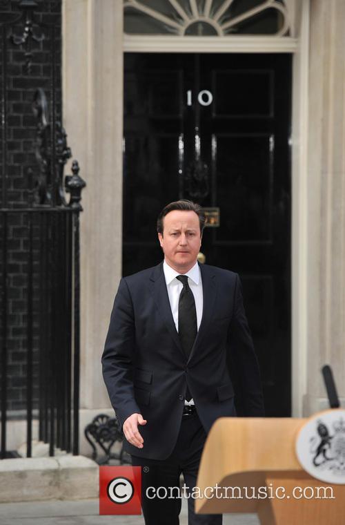 Prime Minister David Cameron speaks outside 10 Downing...