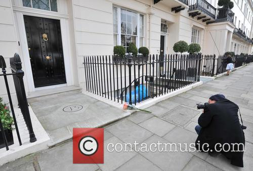 Tributes are laid outside Baroness Margaret Thatcher's London...