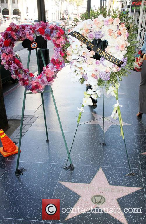 Flowers are placed on Annette Funicello's Hollywood Walk...