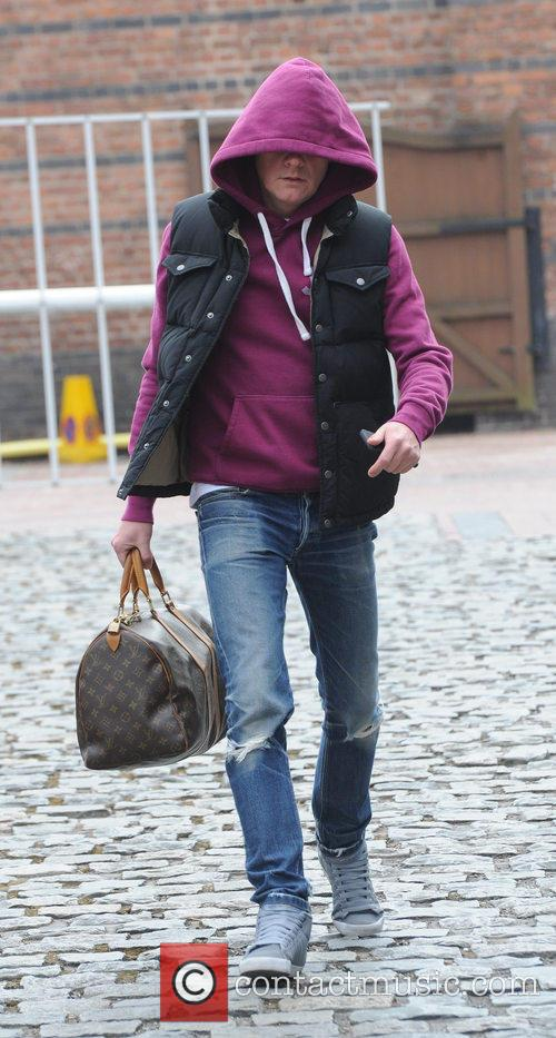 Antony Cotton tries to hide his face as...