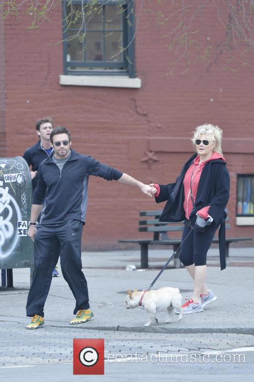 Hugh Jackman and wife Deborra-Lee Furness walk their...