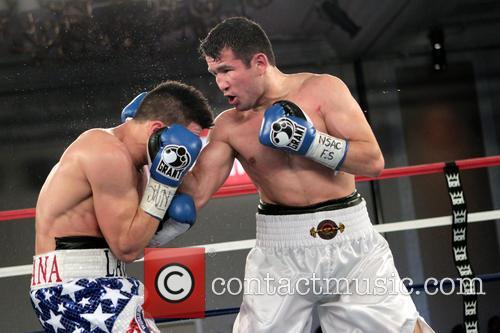 Bahodir Mamadjonov and Angelo Santana 10