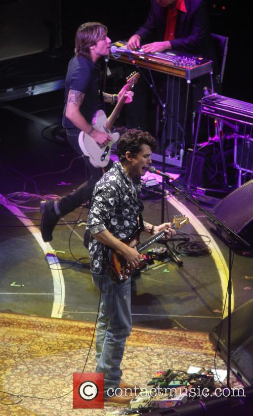 John Mayer and Keith Urban performing together at Crossroads Guitar Festival