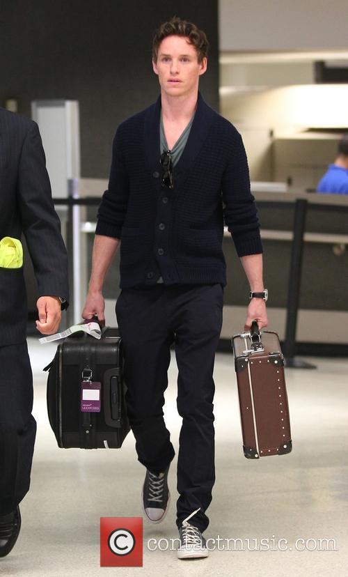 Eddie Redmayne arrives at Los Angeles International (LAX) airport