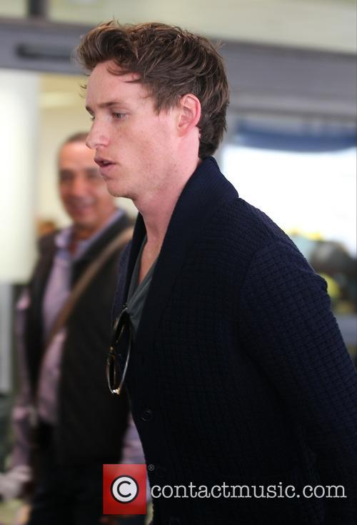 Eddie Redmayne arrives at Los Angeles International (LAX)...