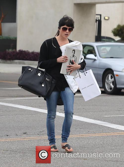 Selma Blair playfully covers her face with the...