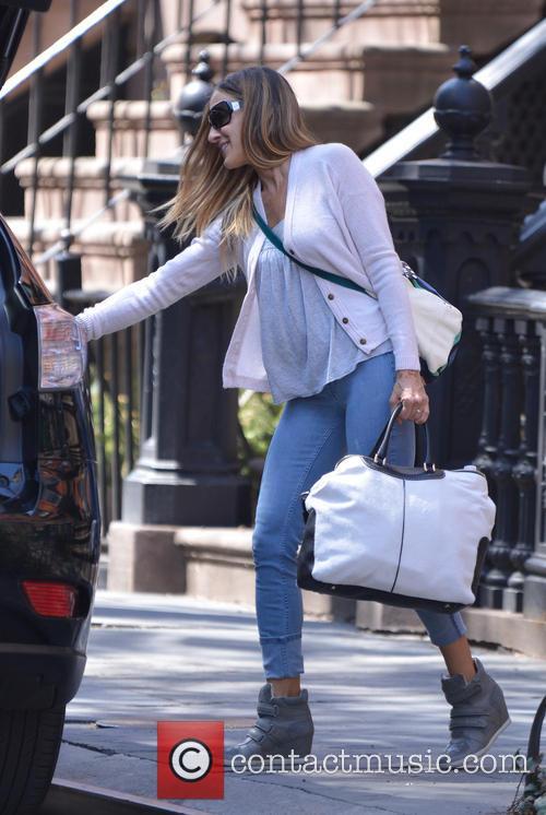 Sarah Jessica Parker exit her home