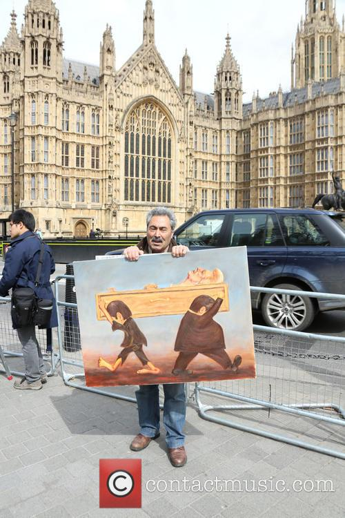 Artist Kaya Mar poses with his painting