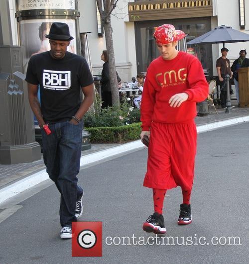 Aaron Carter seen walking through The Grove with...