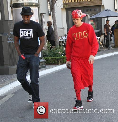 Aaron Carter seen walking through The Grove with...