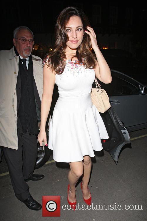 Kelly Brook returns home