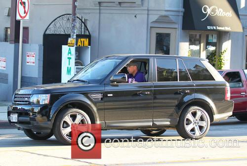 Vinnie Jones and his wife driving along Sunset...