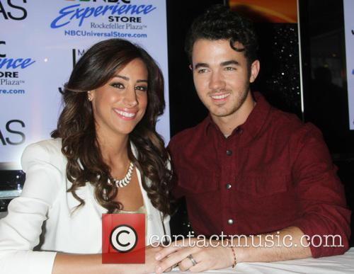 Danielle Jonas and Kevin Jonas signing for their...
