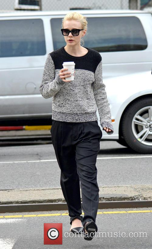 Carey Mulligan grabs a coffee to go with...