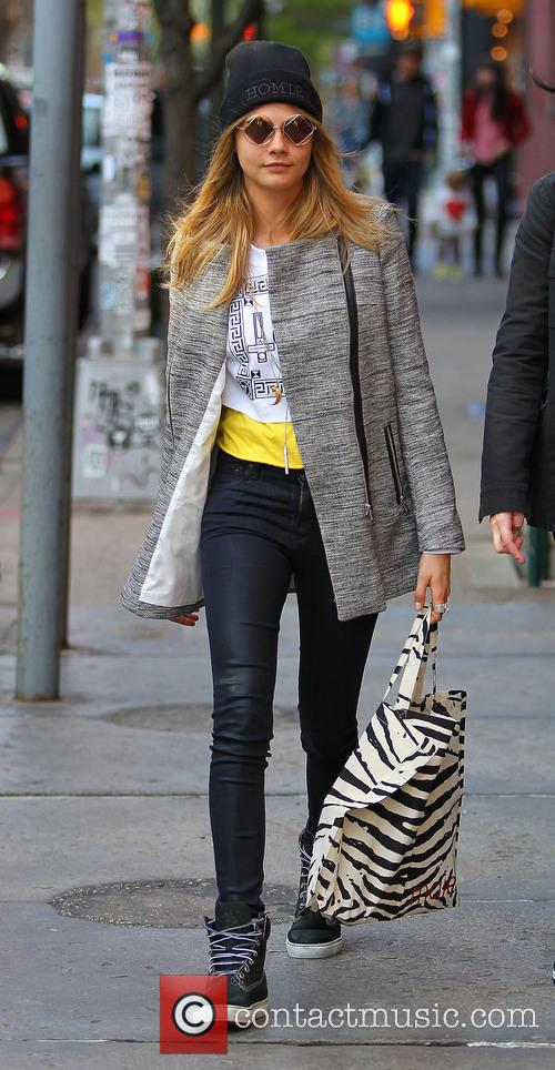 Cara Delevingne looking stylish as she walks in...