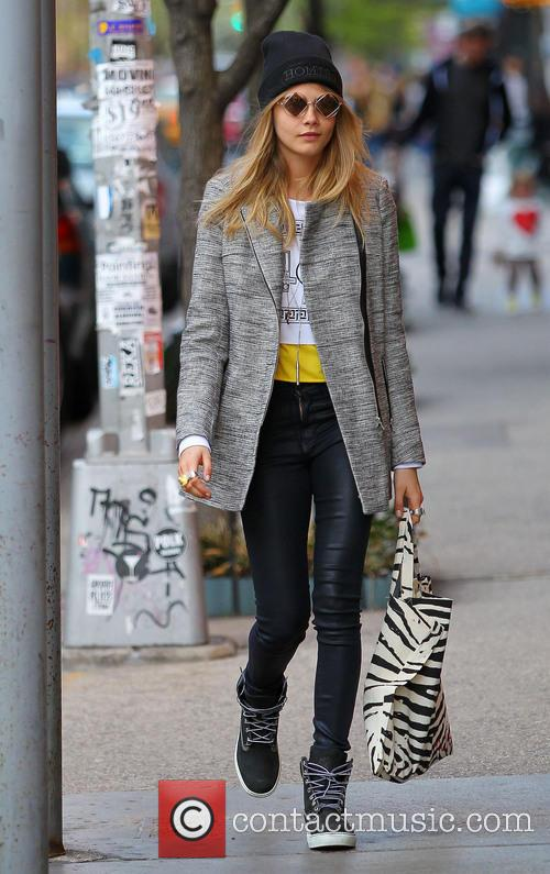 Cara Delevingne looking stylish as she walks in Soho